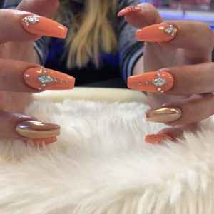 Nail extensions with gel on top and jewels 2