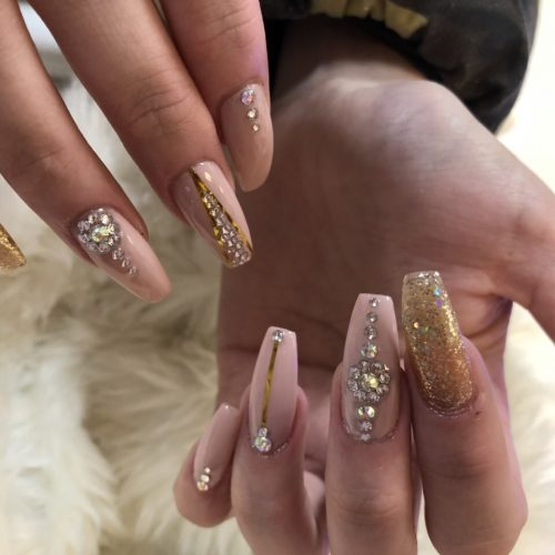 Nail extensions coffin shape with diamonds design